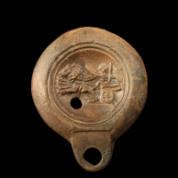 A Roman Pottery Oil Lamp Showing a Biga