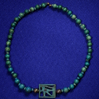 An Egyptian Faience and Silver Necklace
