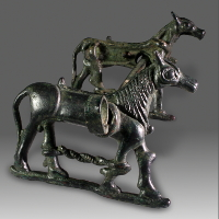 A Luristan Bronze Horse Bit With Cheek Pieces