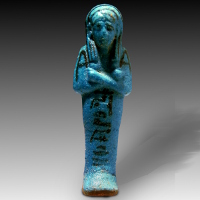 An Egyptian Bright Blue Faience Shabti for Nestanebettawy
