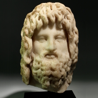 A Roman Marble Head of Zeus-Sarapis