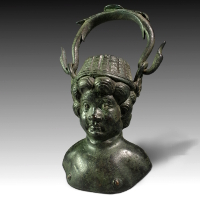 A Roman Bronze Balsamarium with Silver Eyes
