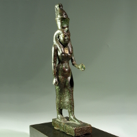 A Large Bronze Statuette of the Goddess Mut with Gold Inlaid Eyes