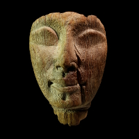 An Egyptian New Kingdom Wood Mask of a Sarcophagus
