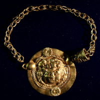 A Romano-Egyptian Gold Necklace Medaillon with Medusa Mask