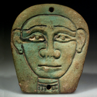 An Egyptian Green Glazed Composition Plaque Showing the Goddess of the Sky