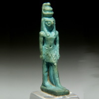 A Glazed Composition Amulet of the God Horus