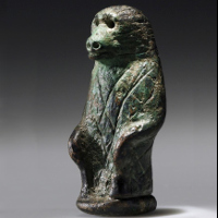 A Rare Egyptian Bronze Sitting Baboon