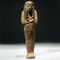 A Large New Kingdom Wood Shabti for Aset