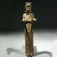 A Bone Votive Statuette of a Woman