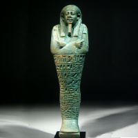 An Egyptian Green Glazed Shabti for Ipethemetes
