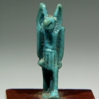 A Glazed Amulet of the God Anubis