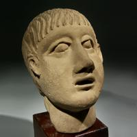 An Etruscan Pottery Head of a Boy
