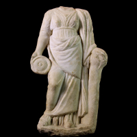 A Marble Statuette of a Priestess or Goddess with Libation Vessel